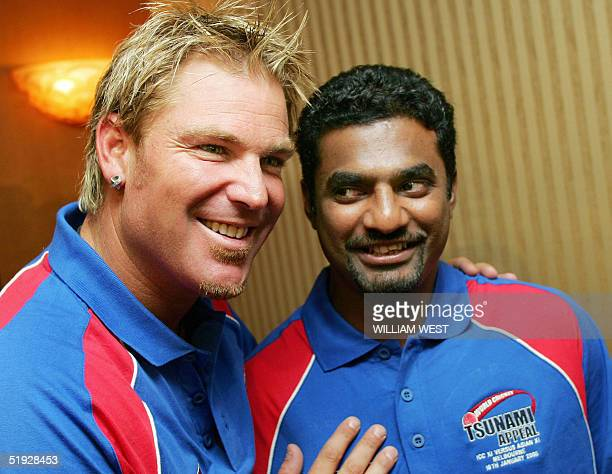 Spinner Shane Warne from Australia who is playing for a Rest of the World cricket team and rival Muttiah Muralitharan from Sri Lanka who is playing...