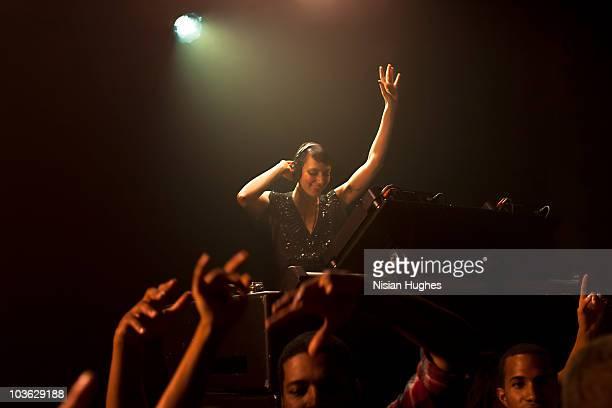 dj spinning at nightclub surrounded by crowd - クラブdj ストックフォトと画像