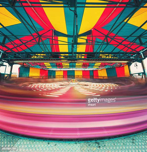 spinning at the carnival - midway stock photos and pictures