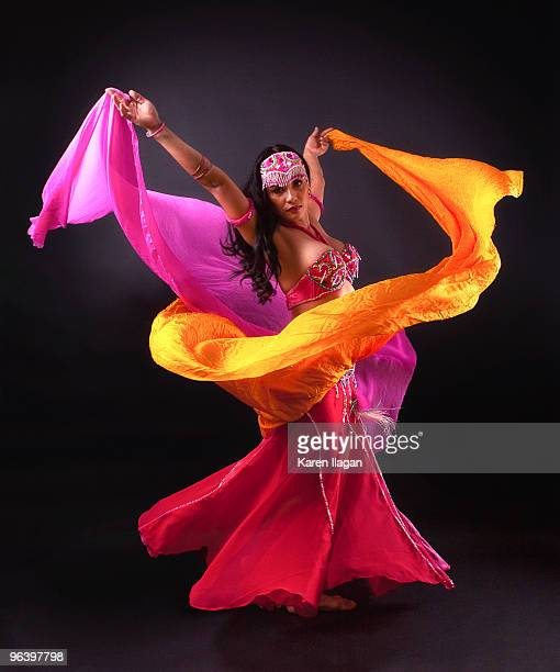 spinning bellydancer - belly dancing stock photos and pictures