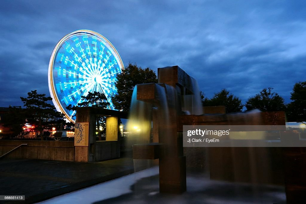 Spinning Ferris Wheel At Seattle Against Cloudy Sky : Stock Photo