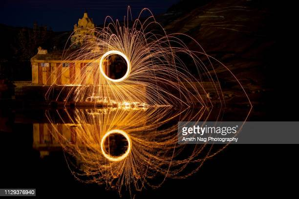 spinning fiery steel wool - parallel stock photos and pictures