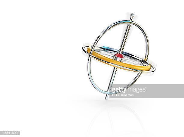 Spinning gyroscope balancing on reflective surface