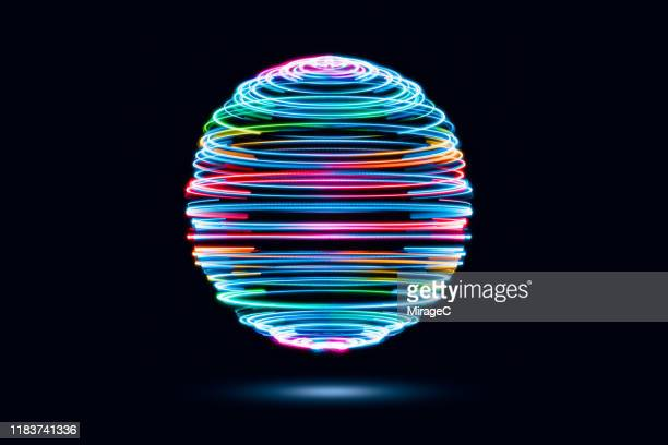 spinning iridescent light trails sphere - light effect stock pictures, royalty-free photos & images