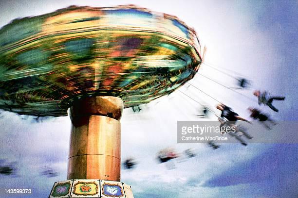 spinning merry go round - catherine macbride stock-fotos und bilder