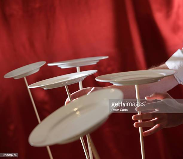 spinning plates - spinning stock pictures, royalty-free photos & images