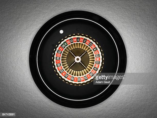 spinning roulette wheel - roulette stock pictures, royalty-free photos & images