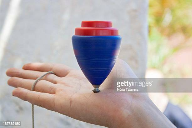 Spinning top on the hand of a boy