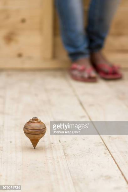spinning top - joshua alan davis stock pictures, royalty-free photos & images