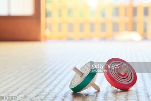 Spinning tops on tatami mat