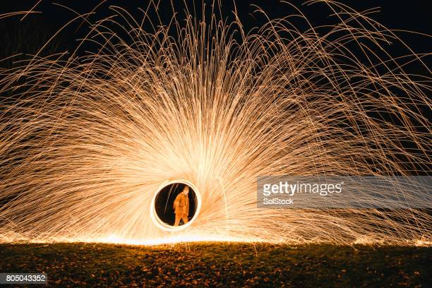 spinning wire wool - igniting stock photos and pictures