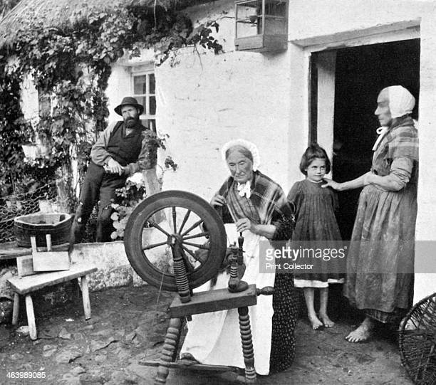 Spinning wool yarn, Cliffony, Sligo, 1908-1909. From Penrose's Pictorial Annual 1908-1909, An Illustrated Review of the Graphic Arts, volume 14,...