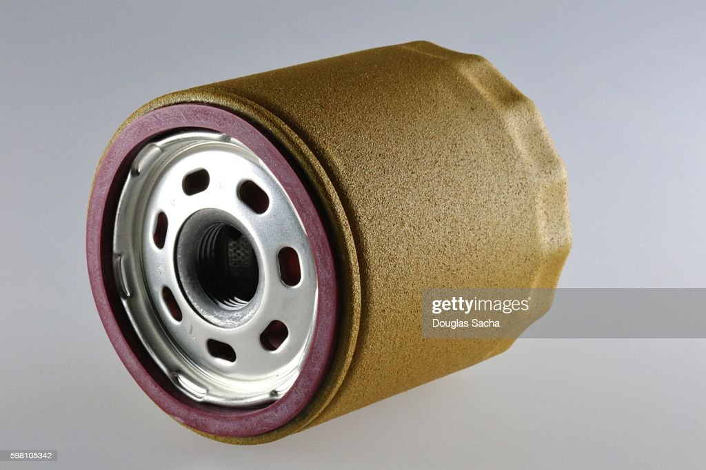 Spin-on canister oil filter showing seal and screw-on thread : Stock Photo