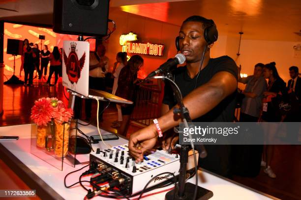 DJ spins as Cheetos unveiled faninspired versions of the #CheetosFlaminHaute look at The House Of Flamin' Haute Runway Show Style Bar Experience...
