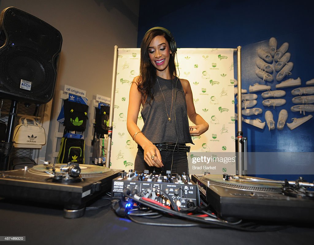 A DJ spins at the American Dad Sneaker Launch at the Adidas Originals Store on October 18, 2014 in New York City. 25167_001_0401.JPG