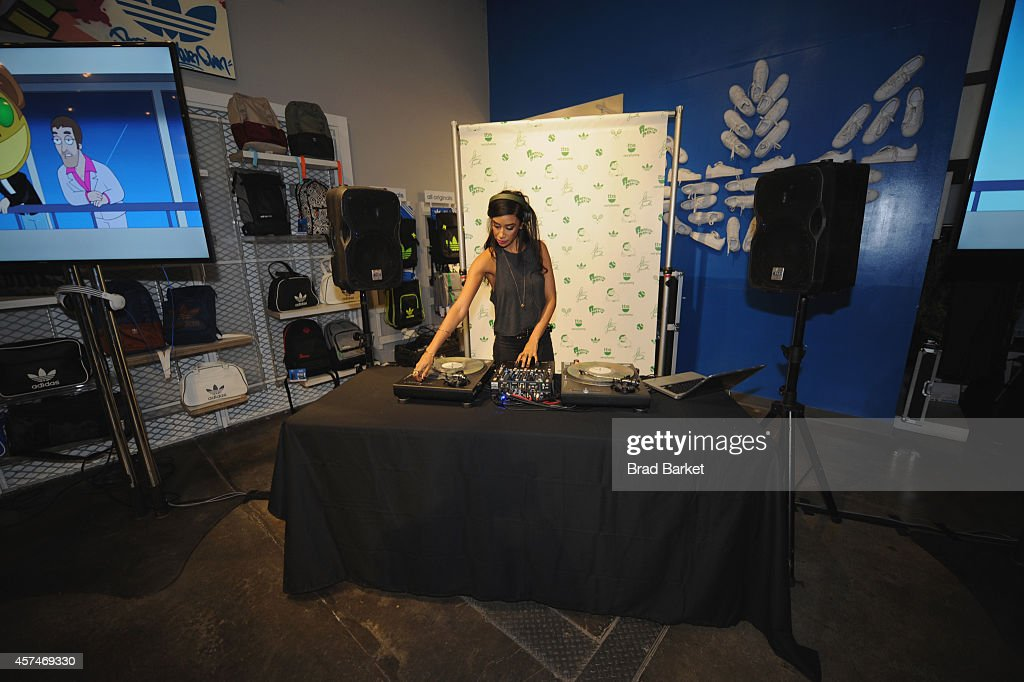 A DJ spins at the American Dad Sneaker Launch at the Adidas Originals Store on October 18, 2014 in New York City. 25167_001_0399.JPG