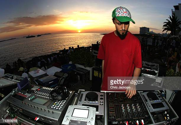 DJ spins records at a party at Cafe Del Mar in San Antonio on May 30 2007 in Ibiza Spain Ibiza remains one of the world's top holiday destinations...