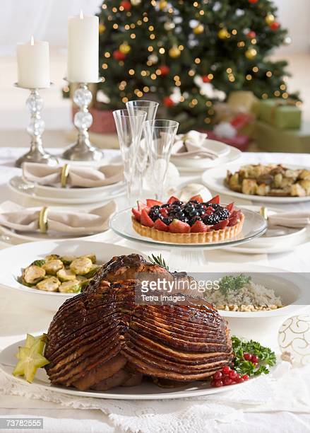 Spiral ham and side dishes on Christmas table
