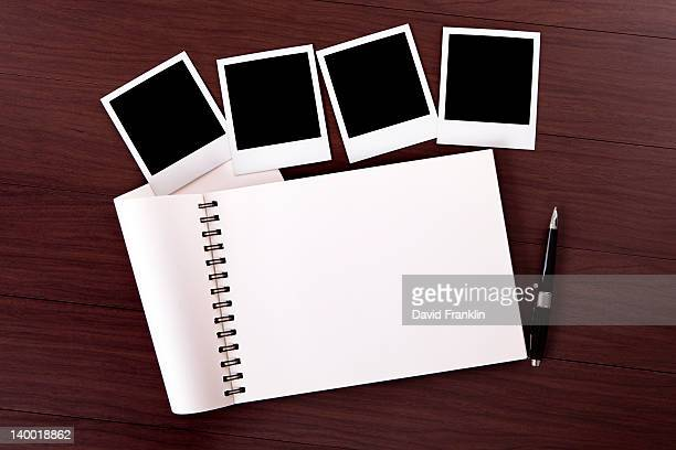 Spiral notebook with blank photo prints