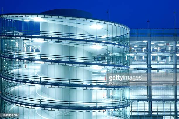 spiral ramp and multi storey car park illuminated at night - parking garage stock pictures, royalty-free photos & images