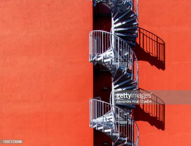 Spiral Staircase Against Orange Building