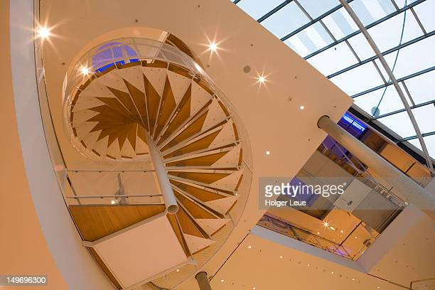 spiral staircase architecture in museum fuer kommunikation. - kommunikation stock pictures, royalty-free photos & images