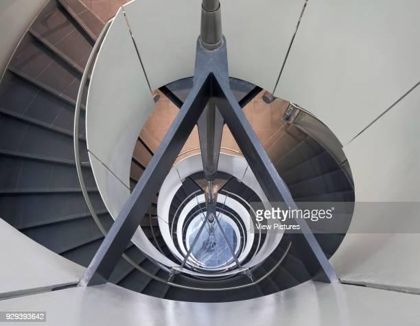 Spiral staircase from above. Siemens Masdar, Abu Dhabi, United Arab Emirates. Architect: Sheppard Robson, 2014.