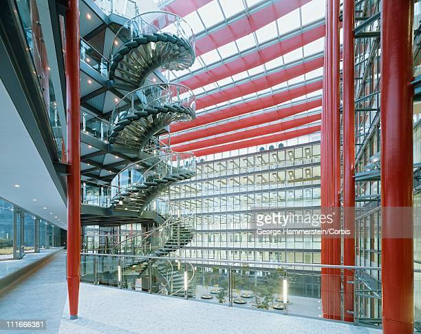 spiral staircase in an office atrium - building atrium stock pictures, royalty-free photos & images