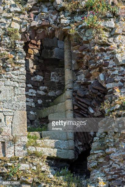 Spiral staircase in the Chateau de Regneville ruined 14th century castle at RegnevillesurMer Manche Coutances Normandy France