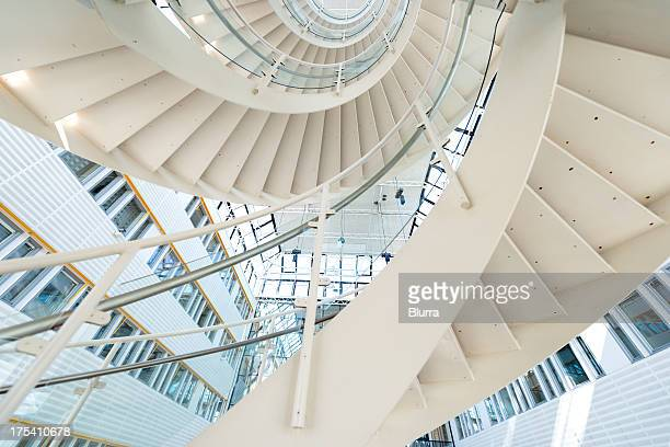 spiral staircase inside office complex - spiral stock pictures, royalty-free photos & images