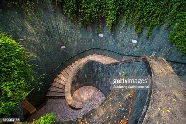 Spiral staircase of underground crossing in tunnel at Fort Canning Park, Singapore