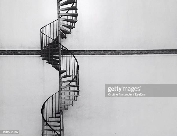 Spiral staircase on wall