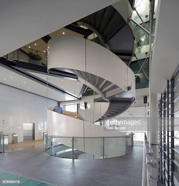 Spiral staircase. Siemens Masdar, Abu Dhabi, United Arab Emirates. Architect: Sheppard Robson, 2014.