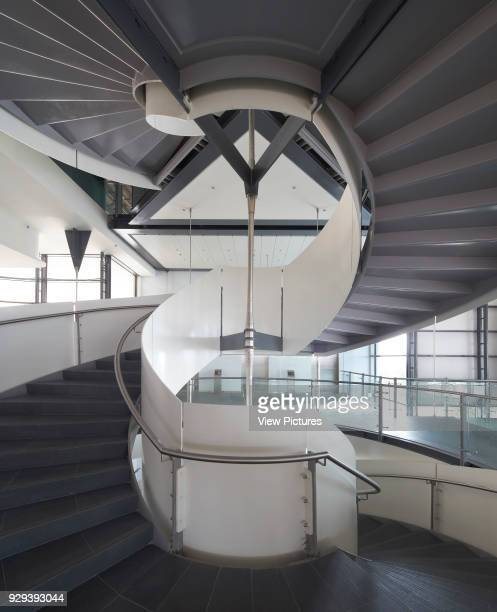 Spiral staircase with treads and soffit. Siemens Masdar, Abu Dhabi, United Arab Emirates. Architect: Sheppard Robson, 2014.