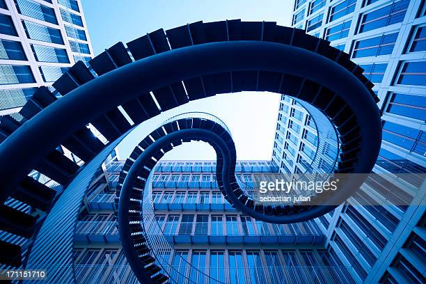 spiral stiars in front of modern architecture