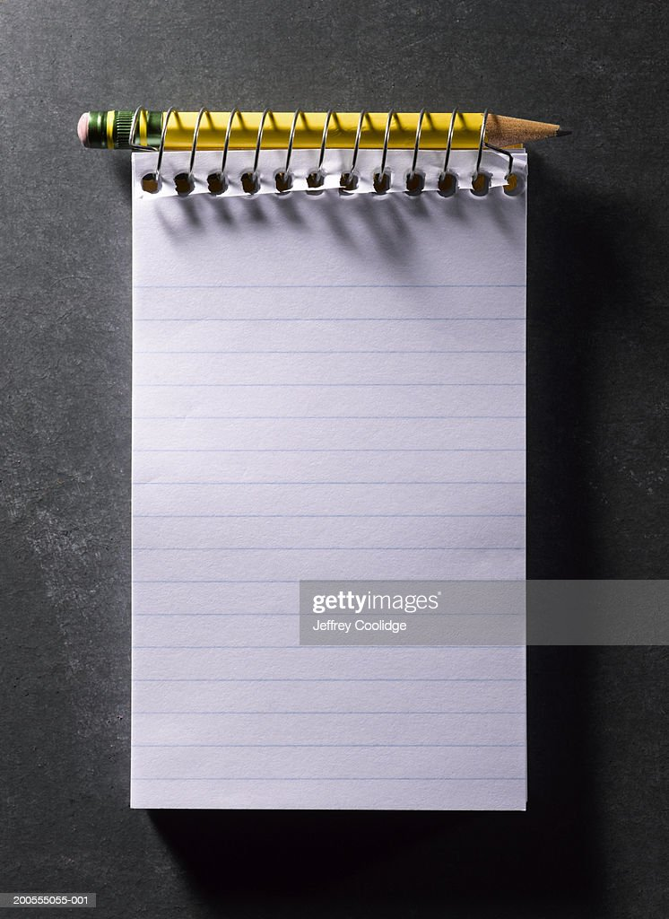 Spiral-bound notebook with pencil, overhead view : Photo