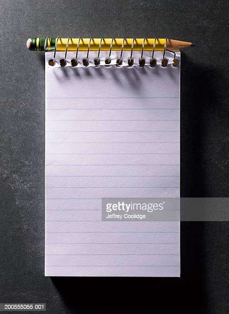 spiral-bound notebook with pencil, overhead view - spiralblock stock-fotos und bilder