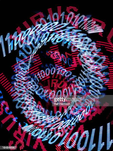 Spirals of blue binary code and the word VIRUS repeated many times in red