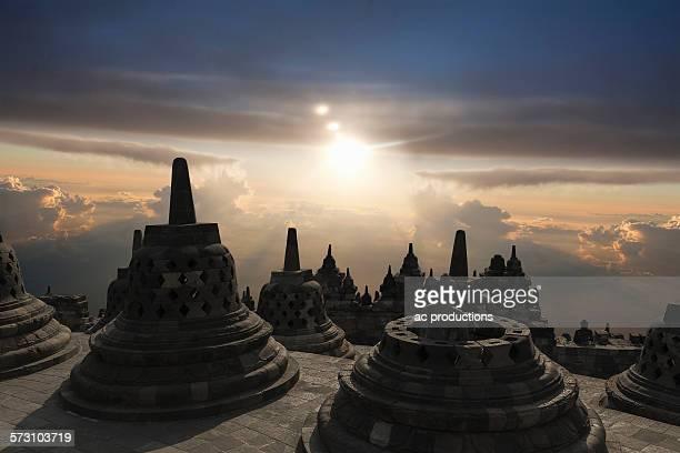 Spires on Temple of Borobudur at sunset, Borobudur, Indonesia