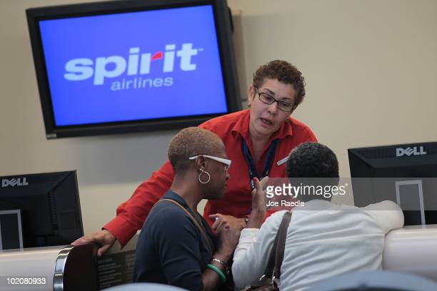 Spirit Airlines Inc employee tries to help passengers with rerouting after all flights were cancelled when the pilots went out on strike at the Fort...