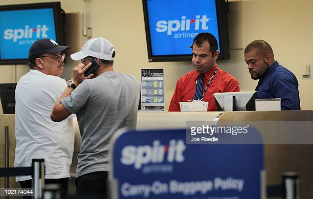 Spirit Airlines Inc employees helps customers at the checkin counter at the Fort Lauderdale International Airport after striking pilots agreed on...