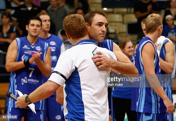 Spirit coach Rob Beveridge is embraced by captain Jason Smith of the Spirit after the round 22 NBL match between the Sydney Spirit and the New...