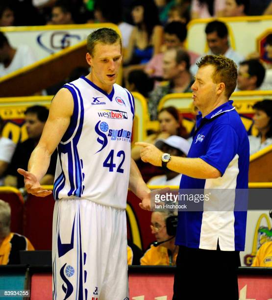Spirit coach Rob Beveridge talks to his player David Gruber during the round 12 NBL match between the Townsville Crocodiles and the Sydney Spirit at...