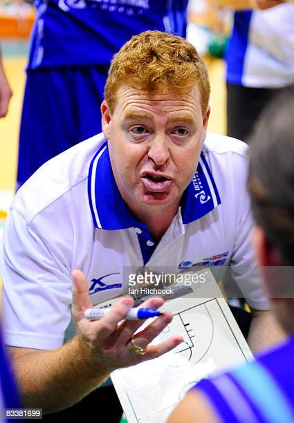 Spirit Coach Rob Beveridge talks to his players during three quarter time in the round six NBL match between the Townsville Crocodiles and the Sydney...