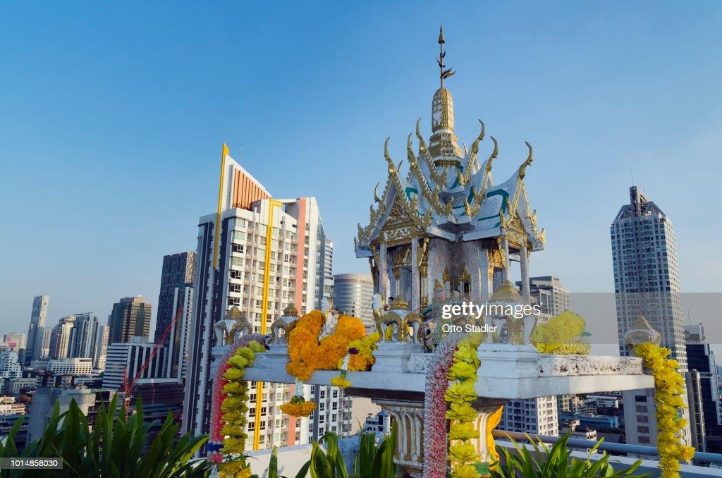 Spirit house and skyscraper in Bangkok : Stock Photo