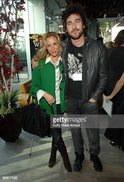 Spirit Nominee Maria Bello and Bryn Mooser attend Film Independent's 2010 Spirit Awards Nominee Brunch at BOA Steakhouse on January 16 2010 in West...