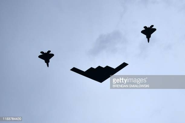 Spirit plane escorted by two F22 Raptors fly past Lincoln Memorial during the Salute to America Fourth of July event in Washington DC July 4 2019