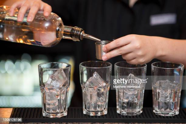 Spirits are poured into glasses on October 19, 2017 in Cardiff, United Kingdom. A new law setting a minimum alcohol price came into force on March 2...