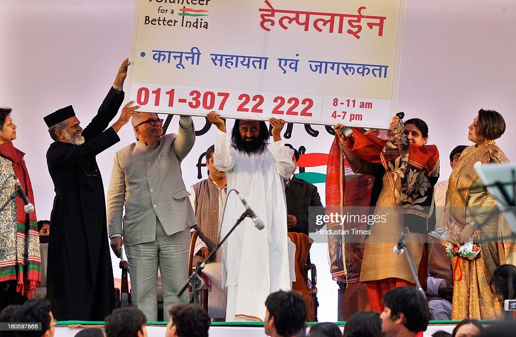 Spiritual leader and founder of Art of Living Foundation Sri Sri Ravishankar launching the 'Volunteer for a Better India' helpline programme in collaboration with UNICEF and other UN bodies on February 3, 2013 in New Delhi, India. Ravishankar said the helplines would be used to provide counselling, medical help and legal aid for persons in distress.