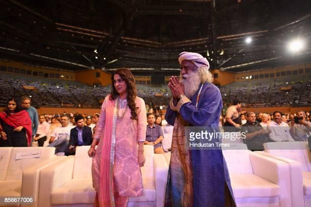 Spiritual leader Sadhguru Jaggi Vasudev with Bollywood actor Juhi Chawla during the 'Rally for Rivers' campaign started by Isha Foundation at Indira...